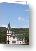 Village Church Greeting Cards - The village church overlooking the harbour in Husavik Iceland Greeting Card by Robert Preston