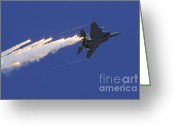 Featured Greeting Cards - An F-15e Strike Eagle Releases Flares Greeting Card by Remo Guidi