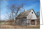 Dilapidated Greeting Cards - An old rundown abandoned wooden barn under a blue sky in midwestern Illinois USA Greeting Card by Paul Velgos