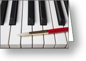 Paintbrush Photo Greeting Cards - Artist brush on piano keys Greeting Card by Garry Gay