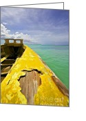 Old World Photography Greeting Cards - Worn Yellow Fishing Boat of Aruba Greeting Card by David Letts