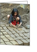 Indian Valley Farm Greeting Cards - Young Girl Making Mud Bricks Central India Greeting Card by Pamela Buol