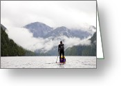 Rain Cloud Greeting Cards - A Man Paddle Boards In The Rain Greeting Card by Taylor S. Kennedy