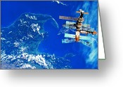 Space.planet Greeting Cards - A Space Station Orbiting Above Earth Greeting Card by Stockbyte