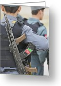Police Officers Greeting Cards - An Ak-47 Rests On The Sling Of An Greeting Card by Terry Moore