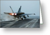 Aircraft Carrier Greeting Cards - An Fa-18 Hornet Launches Greeting Card by Stocktrek Images