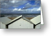 Stormy Sky Greeting Cards - Beach huts under a stormy sky in Normandy Greeting Card by Bernard Jaubert