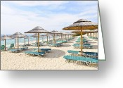 Umbrella Greeting Cards - Beach umbrellas on sandy seashore Greeting Card by Elena Elisseeva