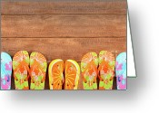 Footwear Greeting Cards - Brightly colored flip-flops on wood  Greeting Card by Sandra Cunningham