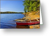 Aluminum Greeting Cards - Canoe on shore Greeting Card by Elena Elisseeva