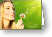 Holding Flower Greeting Cards - Happy beautiful girl blowing dandelion  Greeting Card by Anna Omelchenko