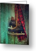 Old Skates Greeting Cards - Old ice skates hanging on barn wall Greeting Card by Sandra Cunningham