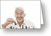 Head Piece Greeting Cards - Senior Man Playing Chess Greeting Card by