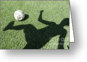 Kicking Football Greeting Cards - Shadow playing football Greeting Card by Mats Silvan