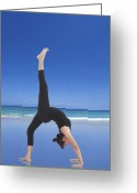 Coach Greeting Cards - Woman doing yoga on the beach Greeting Card by Setsiri Silapasuwanchai