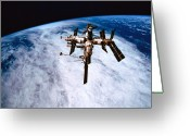 Space.planet Greeting Cards - A Space Station In Orbit Above The Earth Greeting Card by Stockbyte