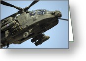 Agm-114 Greeting Cards - An Ah-64 Apache In Flight Greeting Card by Terry Moore