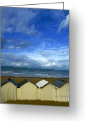Shorelines Greeting Cards - Beach huts under a stormy sky in Normandy Greeting Card by Bernard Jaubert