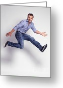 Gray Pants Greeting Cards - Jumping Young Man Greeting Card by Oleksiy Maksymenko