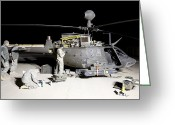 Agm-114 Greeting Cards - Maintenance Crew Works On Servicing Greeting Card by Terry Moore