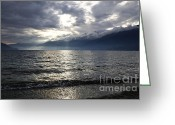Dark Grey Greeting Cards - Sunlight over a lake Greeting Card by Mats Silvan