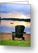 Beach Scenery Greeting Cards - Wooden chair at sunset on beach Greeting Card by Elena Elisseeva