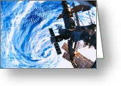 Shuttle Greeting Cards - A Space Station Orbiting Above Earth Greeting Card by Stockbyte