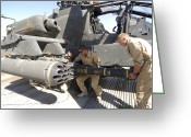 Agm-114 Greeting Cards - Aircrew Loading An Agm-114 Hellfire Greeting Card by Andrew Chittock