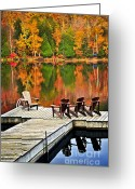 Orange Greeting Cards - Wooden dock on autumn lake Greeting Card by Elena Elisseeva