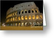 Ancient Rome Greeting Cards - Coliseum illuminated at night. Rome Greeting Card by Bernard Jaubert