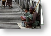 Burma Greeting Cards - A beggar on the U Bein Bridge Greeting Card by RicardMN Photography