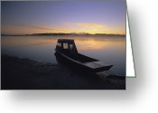 River Scenes Greeting Cards - A Boat Sits On The Calm Yukon River Greeting Card by Michael Melford