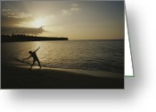 Republican Greeting Cards - A Child, Silhouetted At Sunset, Throws Greeting Card by Raul Touzon