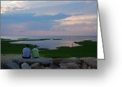 Oceans And Seas Greeting Cards - A Couple Sit On A Rock Watching Sunset Greeting Card by Darlyne A. Murawski