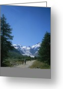 Tourists And Tourism Greeting Cards - A Couple Walks Toward The Morteratsch Greeting Card by Taylor S. Kennedy