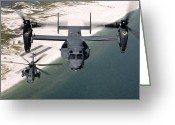 Airplane Greeting Cards - A Cv-22 Osprey And An Mh-53 Pave Low Greeting Card by Stocktrek Images