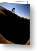 Rock Formations Greeting Cards - A Cyclist Riding On The Slick Rock Greeting Card by Bill Hatcher
