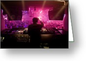 Speakers Greeting Cards - A Dj Plays To His Crowds On A Busy Greeting Card by Justin Guariglia