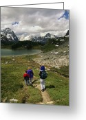 Hikers And Hiking Photo Greeting Cards - A Family Hikes Toward A Lake In Yoho Greeting Card by Michael Melford
