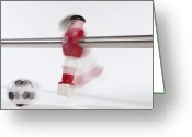 Player Photo Greeting Cards - A Foosball Figurine Kicking A Soccer Ball, Blurred Motion Greeting Card by Caspar Benson