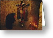 Female Likeness Greeting Cards - A Greek Pilgrim Prays In The Grotto Greeting Card by Annie Griffiths