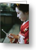 Kansai Triangle Greeting Cards - A Kimono-clad Geisha Dials Her Cell Greeting Card by Justin Guariglia