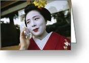 Kansai Triangle Greeting Cards - A Kimono-clad Geisha Talks On A Cell Greeting Card by Justin Guariglia