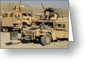 Armored Vehicles Greeting Cards - A M1114 Humvee Sits Parked In Front Greeting Card by Stocktrek Images