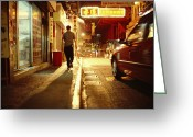 City Lights And Lighting Greeting Cards - A Man And A Taxi On A Shop-lined Hong Greeting Card by Justin Guariglia