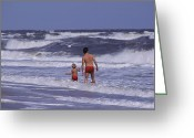Humans Greeting Cards - A Man And Child Play In The Assateague Greeting Card by Medford Taylor