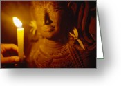 Asian Architecture And Art Greeting Cards - A Man Holds A Candle Up To A Stone Greeting Card by Justin Guariglia