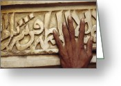 Of Buildings Greeting Cards - A Man Runs His Hand Over Arabic Script Greeting Card by Justin Guariglia