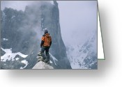 Standing Out From The Crowd Greeting Cards - A Man Stands On A Cliff Watching Greeting Card by Jimmy Chin