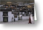 Tibetan Buddhism Greeting Cards - A Monk Walks Past A Small Village Greeting Card by Jimmy Chin